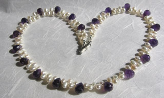 Fresh water pearl and amethyst drops, sterling silver heart toggle clasp.